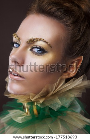 beauty portrait of a golden queen of elves