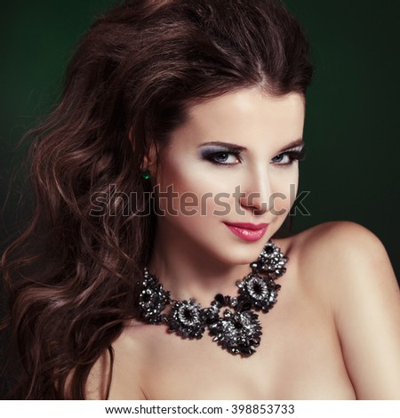 Beauty portrait of a gorgeous girl in necklace
