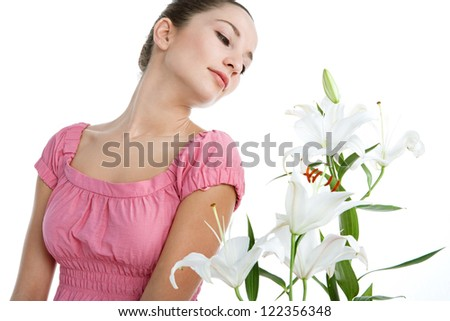 Beauty portrait of a hispanic young woman smelling a bunch of white lilies flowers, isolated on a white background. - stock photo