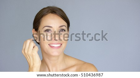 Beauty portrait of a smiling young brunette woman