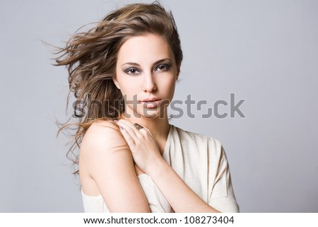 Beauty portrait of a striking gorgeous young brunette. - stock photo