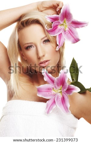 beauty portrait of a woman with a flower on white background