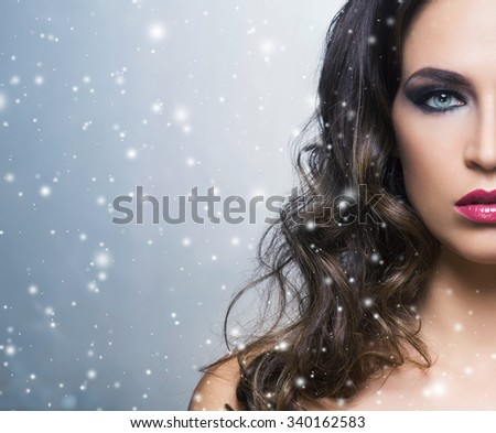 Beauty portrait of a young and gorgeous woman over winter background.