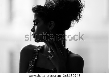 Beauty portrait of a young beautiful brunette girl  - stock photo