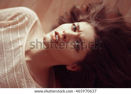 Beauty portrait of a young beautiful brunette girl with long black straight flying hair. The concept of anxiety, worry, misunderstanding and oppression