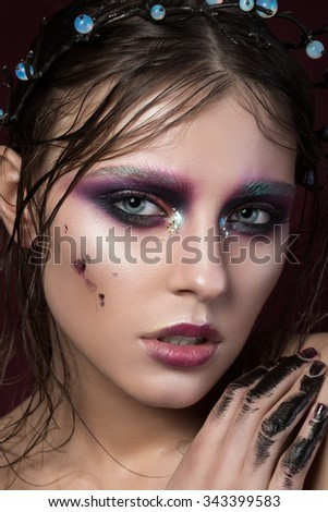 Beauty portrait of a young girl with fashion creative make-up. Colourful smoky eyes. Beauty face