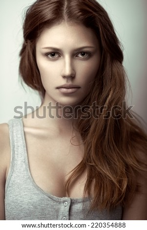 Beauty portrait of a young sensual model with long wavy brown hair. - stock photo