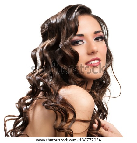 Beauty portrait of attractive brunette with curly hairstyle.Isolated on white. - stock photo