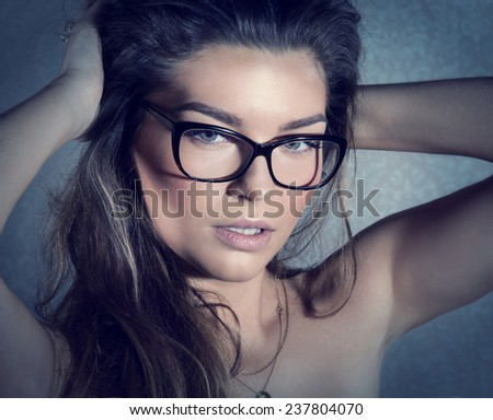 Beauty portrait of attractive brunette woman with perfect makeup. Closeup photo. - stock photo