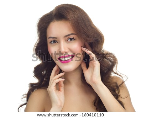 beauty portrait of attractive  caucasian smiling woman brunette isolated on white studio shot  lips toothy smile face long hair hands head and shoulders looking at camera - stock photo