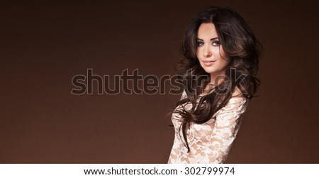Beauty portrait of attractive delicate brunette woman. Studio shot. Girl with brown eyes and perfect makeup.Smiling. - stock photo