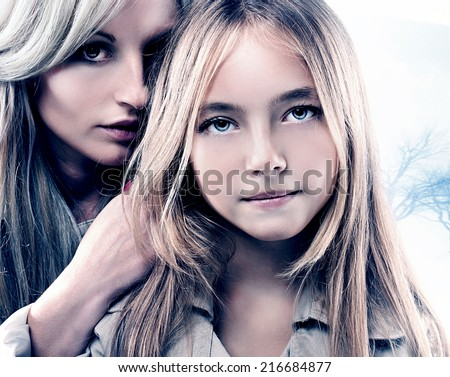 Beauty portrait of attractive mother with pretty daughter. Family time. Fashion photo.