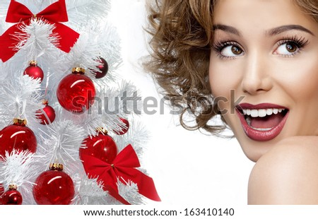 beauty portrait of attractive smiling young caucasian woman christmas tree face closeup skin teeth studio shot - stock photo