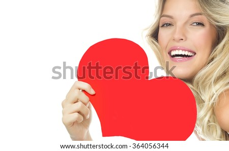 beauty portrait of attractive young caucasian smiling woman blond isolated on white studio shot  toothy smile face long hair head and shoulders looking at camera red heart valentine's love - stock photo