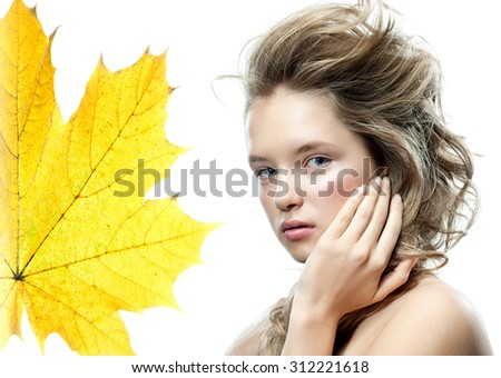 beauty portrait of attractive young caucasian woman blond isolated on white studio shot  face long hair head and shoulders looking at camera autumn yellow maple leaf - stock photo