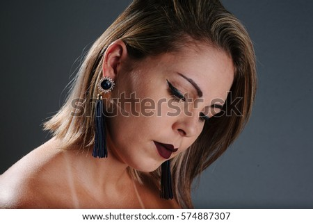 Beauty portrait of beautiful woman wearing handmade earrings