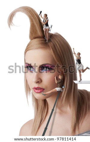 beauty portrait of blond young girl with her make up and creative hair style under costruction with little worker - stock photo