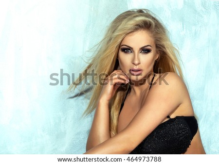 Beauty portrait of blonde sensual woman with glamour makeup. Long lashes. Elegant lady.