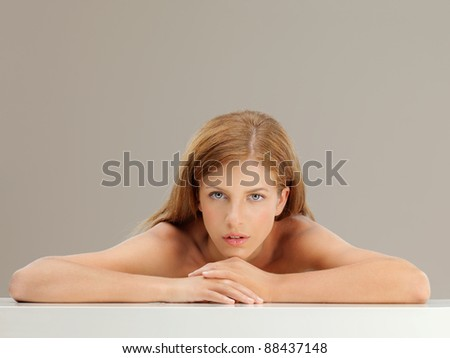 beauty portrait of blonde woman looking at camera - stock photo