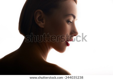 beauty portrait of caucasian woman in white backlight - stock photo
