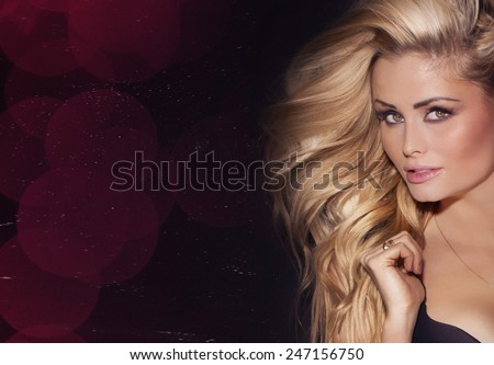 Beauty portrait of delicate blonde woman with long  hair. Girl looking at camera. - stock photo