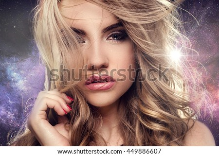 Beauty portrait of elegant young woman. Girl looking at camera. Glamour makeup.