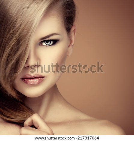 Beauty portrait of fashion girl with professional makeup and hairstyle with copy space. - stock photo