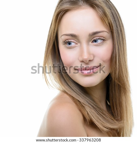 Beauty portrait of girl with beautiful healthy face and long blond hair looking down, over white background