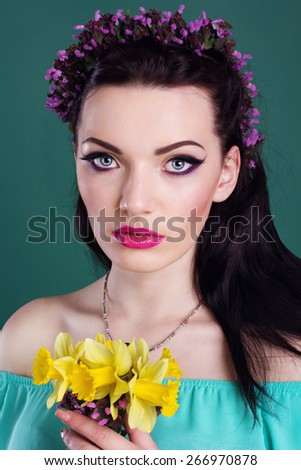 Beauty portrait of girl with purple wreath of flowers in hair - stock photo