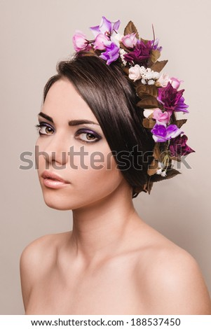 beauty portrait of girl with violet make-up and flowers - stock photo