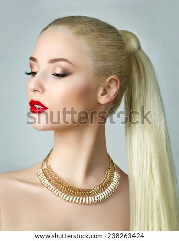 Beauty portrait of gorgeous blonde woman with ponytail - stock photo