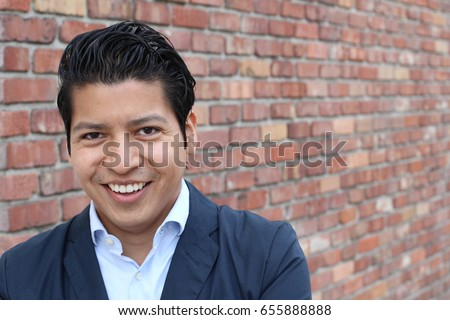Beauty Portrait of Handsome Hispanic Young Male Smiling Outdoors