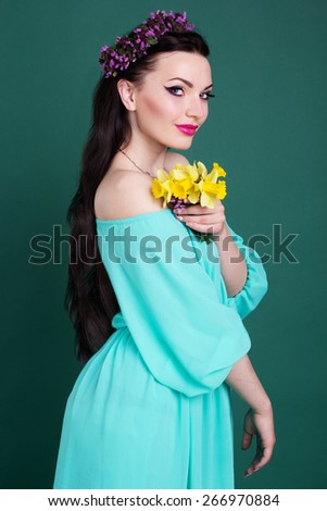 Beauty portrait of pretty teen girl with purple wreath of flowers in hair - stock photo