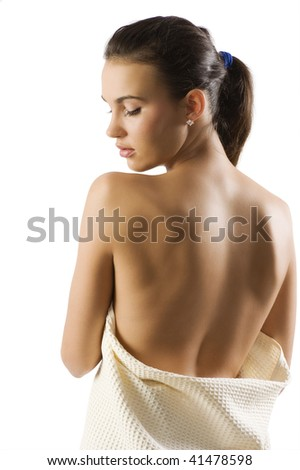 beauty portrait of pretty woman dressing a white bath towel and showing her naked shoulder - stock photo