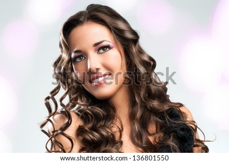 Beauty portrait of Stunning brunette with curly hairstyle. - stock photo