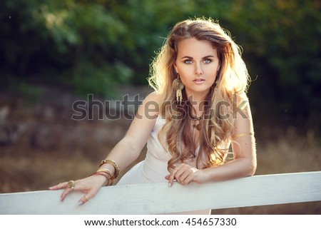 Beauty portrait of the girl with flash tattoo in boho style