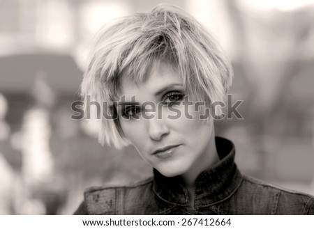beauty portrait of woman in thirties with interesting hair
