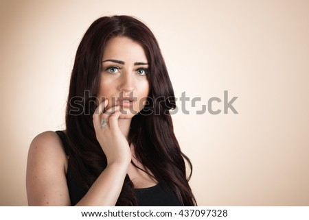 Beauty portrait of woman touching face with plenty of copy space - stock photo