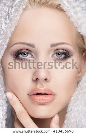 Beauty portrait of young attractive blonde woman with natural makeup. Beautiful female face. Closeup photo. - stock photo