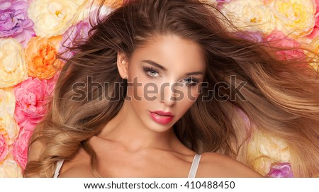 Beauty portrait of young attractive blonde woman with natural makeup. Beautiful female face. Closeup photo.