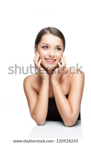 beauty portrait of young attractive brunette caucasian female which toothy smiling and looking away and isolated on white background. professional makeup, hairstyle and retouching