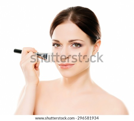 Beauty portrait of young, attractive, fresh, healthy and natural woman holding a makeup brush isolated on white - stock photo