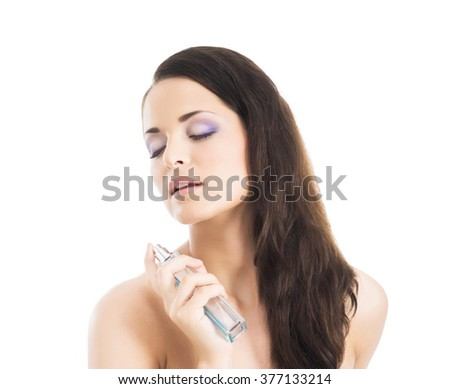 Beauty portrait of young, attractive, fresh, healthy and natural woman with the perfume bottle isolated on white