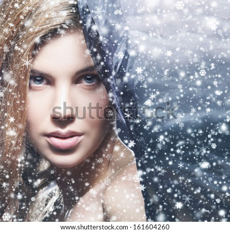 Beauty portrait of young attractive woman over snowy Christmas background - stock photo