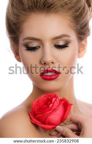 Beauty portrait of young beautiful woman holding red rose isolated on white background. SPA concept. - stock photo