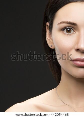 Beauty portrait of young brunette caucasian attractive sad woman with natural make-up. Studio portrait.  - stock photo
