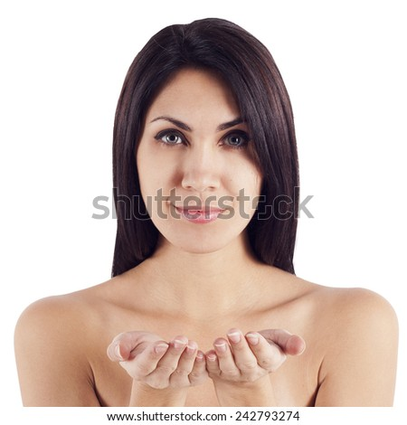 Beauty portrait of young caucasian woman holding something in hands - stock photo