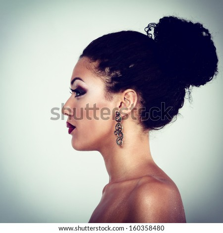 Beauty portrait of young mulatto fresh fashion woman in profile, toned - stock photo