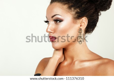 Beauty portrait of young mulatto fresh woman with beautiful makeup in profile - stock photo