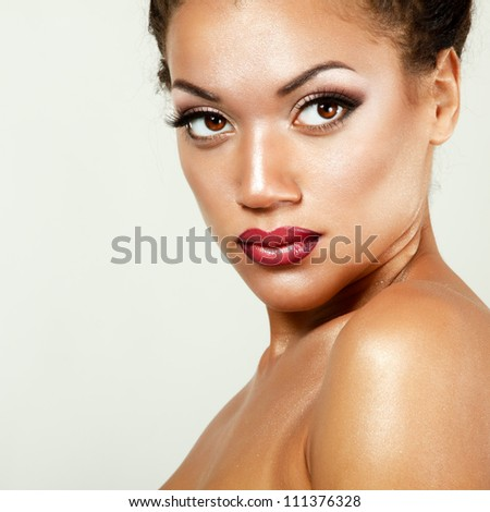Beauty portrait of young mulatto fresh woman with beautiful makeup. Isolated on white background - stock photo
